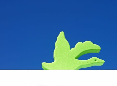Whimsical bird against blue background photo