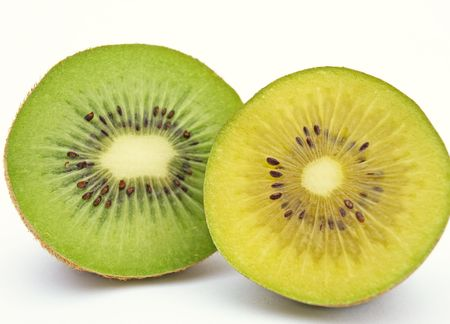 Gold and green kiwi slices isolated on white background
