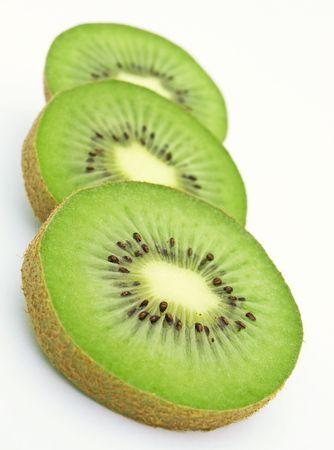 Three slices of green kiwi Stock Photo