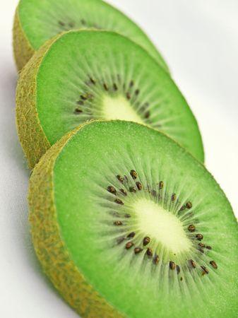 Three green kiwi slices Stock Photo