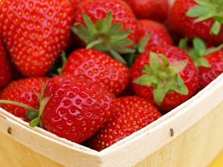 Strawberries in basket up close      Stock Photo