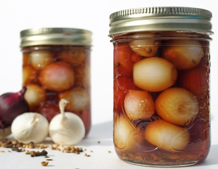 pickled: Two jars of pickled onions