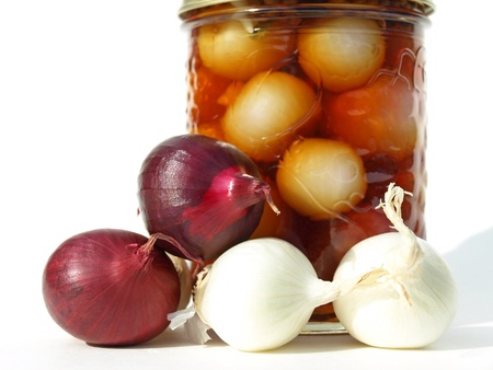 White and red onions with jar Stock Photo