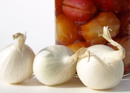 White onions and jar Stock Photo