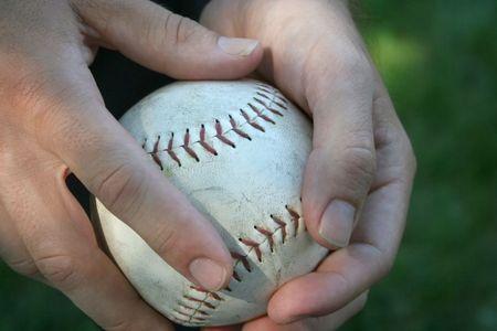 grasp: hands holding a baseball