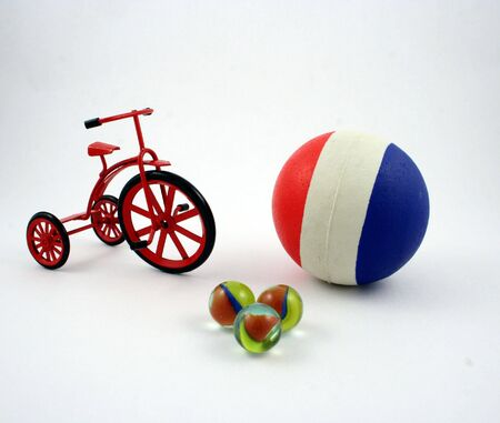 A ball, some marbles and a cast-iron tricycle photo