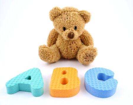 A teddy bear and some letters photo