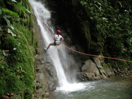 A woman scaling a challenging and dangerous falls.    Its not me here but I came before her.