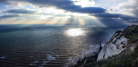 seven sisters: Dramatic clouds and sea. Sunshine from the clouds near Seven sisters in England. Stock Photo