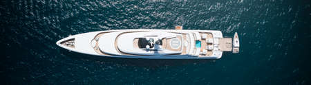 View from above, stunning aerial view of a luxury yacht sailing on a blue water. Costa Smeralda, Sardinia, Italy. Archivio Fotografico