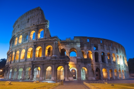 Romes mighty Coliseum (AD 80), illuminated at night and icon of the city, still standing today as a testament to ancient engineering.