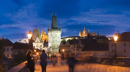 st charles: Pretty night time illuminations of Charles Bridge (1357), Little Quarter Tower, St Nicholas Church and St Vitus Cathedral (1714) in the magical city of Prague. Editorial