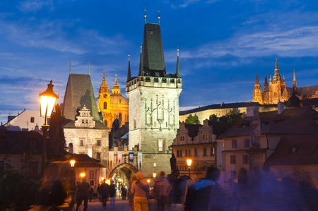 Pretty night time illuminations of Charles Bridge (1357), Little Quarter Tower, St Nicholas Church and St Vitus Cathedral (1714) in the magical city of Prague.