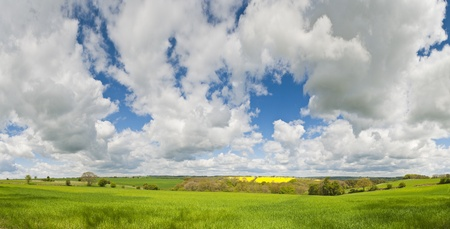 Idyllic rural view of pretty farmland with white fluffy clouds, in the beautiful surroundings of the Cotswolds, England, UK  photo