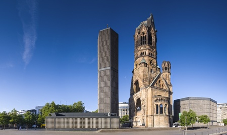 Kaiser-Wilhelm-Gedächtnis-Kirche, broken spire and modern bell tower overlook the busy Breitscheidplatz as symbols of the city Editorial