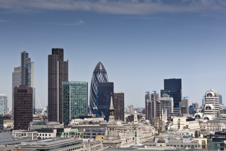 30 st mary axe: Clear blue sky panoramic of the iconic and varied skyscrapers in the financial district of London. View includes the Gherkin (30 St Mary Axe) and Tower 42.