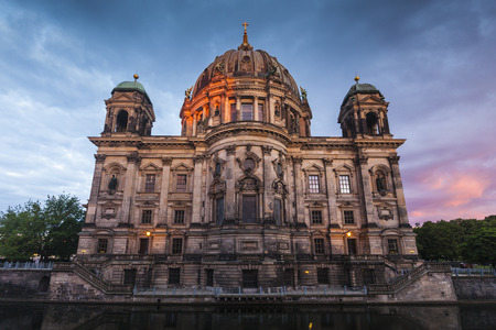hues: Salmon pink hues of first light illuminating the Berlin Cathedral in Berlin, Germany.