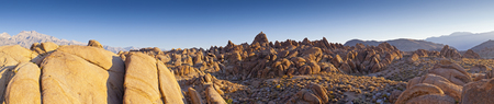 First light at the Sierra Nevada mountains. Warm morning hues illuminate the weird and wonderful rock formations of the Alabama Hills in California, which is a popular filming location for television and movie productions. photo