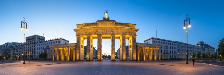 Pretty night time illuminations of the Brandenburg Gate (1788) inspired by Greek architecture, built as a symbol of peace and nationalism, now an emblem of reunification. photo