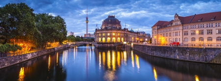 east germany: Pretty night time illuminations of the Bode Museum (1904) which is part of the complex of museums that make up Museum Island in Berlin, Germany. East German, Fernsehturm Television Tower visible in background.