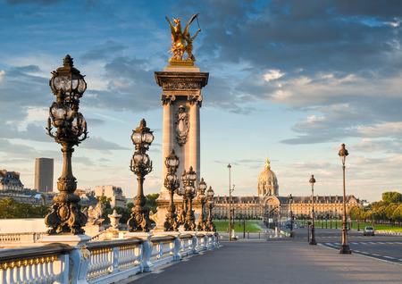 les: Stunning Pont Alexandre III bridge  1896  spanning the river Seine  Decorated with ornate Art Nouveau lamps and sculptures it is the most extravagant bridge in Paris