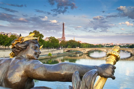 champs elysees quarter: Eiffel Tower and Pont Alexandre III bridge  1896  spanning the river Seine  Decorated with ornate Art Nouveau lamps and sculptures it is the most extravagant bridge in Paris