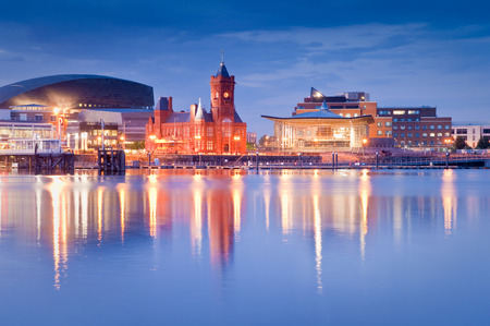 cardiff: Pretty night time illuminations of the stunning Cardiff Bay, many sights visible including the Pierhead building (1897) and National Assembly for Wales.