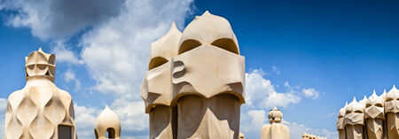 Rooftop detail of surreal modernist chimneys in Barcelona, built by Gaudi in 1905  photo