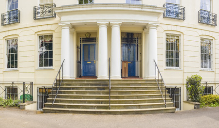 terraced: Traditional houses fronted by well kept gardens and railings. Stitched panoramic image.