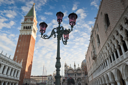 st marks square: Warm early morning light on the stunning renaissance (14th and 15th century) architecture in St Marks Square, Venice. Doges Palace, Campanile, Liberia Sansoviniana and Basilica di San Marco all visible. Stock Photo