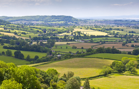 gloucestershire: Idyllic rural view of gently rolling patchwork farmland and villages with pretty wooded boundaries, in the beautiful surroundings of the Cotswolds, England, UK.