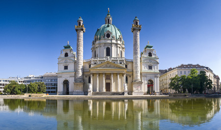 influenced: Beautiful baroque Karlskirche Church influenced by oriental architecture built in 1715 in the beautiful city of Vienna. Stock Photo