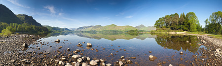 borrowdale: Summer woodland at Derwent Water with dramatic Latrigg mountain backdrop in the beautiful English Lake District  Stitched panoramic image detailed when viewed large
