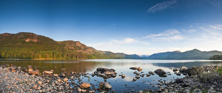 Summer woodland at Derwent Water with dramatic Latrigg mountain backdrop in the beautiful English Lake District  Stitched panoramic image detailed when viewed large