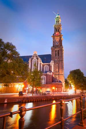 westerkerk: Pretty night time illuminations of the magnificent Westerkerk Church (1620) standing as a symbol of Amsterdam, Holland.