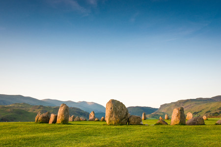 borrowdale: Ancient Castlerigg stone circle  3200 BC  illuminated by warm early morning sunlight in the Lake District UK  Stock Photo