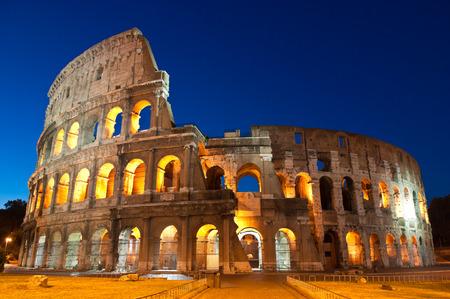 palatine: Mighty Coliseum (AD 80), illuminated at night, Rome, Italy.