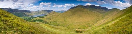 fells: Mountain peaks and blue sky in Eskdale valley, Lake District, UK