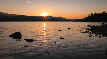borrowdale: Sun setting over a perfectly still Derwent Water in the beautiful Lake District, UK.