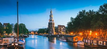 Pretty night time illuminations of the Montlebaanstoren Tower (1512) overlooking Oosterdk in central Amsterdam. photo