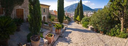 siesta: Hillside villas overlook traditional mediterranean view and mountains. Stock Photo