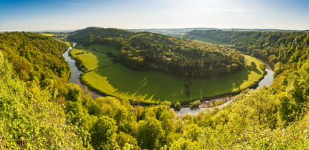 dean: Meandering River Wye making its way through lush green rural farmland in the warm early sunlight