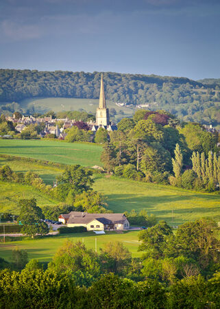 Idyllic rural view of gently rolling patchwork farmland and villages with pretty wooded boundaries, in the beautiful surroundings of the Cotswolds, England, UK
