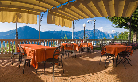Pretty restaurant tables with a stunning Italian mountain view.