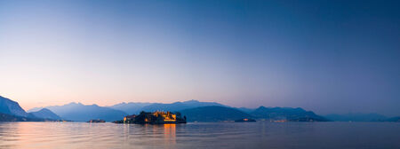 maggiore: Setting sun illuminating the night time scene of the beautiful Borromean islands on Lake Maggiore in Italy.