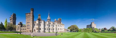 welsh: Cardiff Castle, welsh flag flying, situated within beautiful parklands in the heart of the city.
