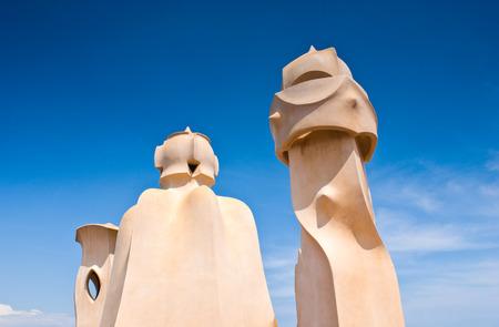 modernist: Rooftop detail of surreal modernist chimneys in Barcelona, built by Gaudi in 1905.