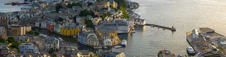 alesund: Blue sky and reflections of the pretty fishing town of Alesund in Norway.