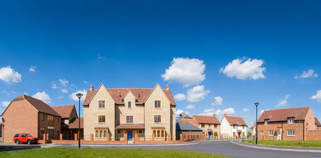 panoramic: Affordable new build housing and summer sky.