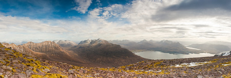 snowcapped: Dramatic view of beautiful Wester Ross snowcapped mountains from Beinn Alligin, Torridon, Scotland. Stock Photo